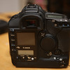 Canon 1ds ii, no box, but comes w/ 3 batteries, charger, ac adapter/battery pack. One of the batteries has the little handle broken off, see pics, but can still easily be installed into the camera using your thumb.  Shutter count is 86,638<br /> <br /> $1800 shipped.