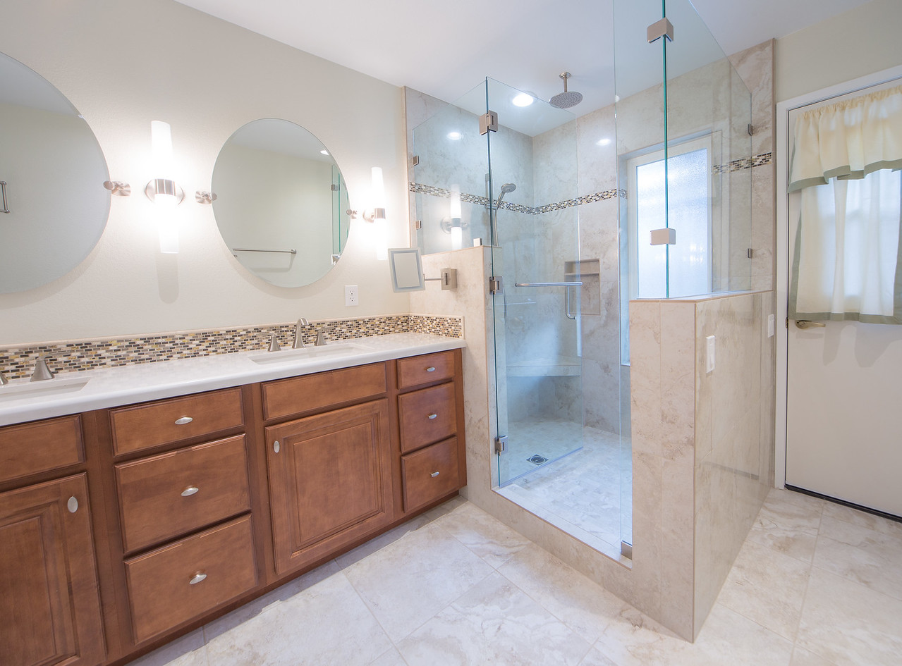 Philips Master Bath Shower has rain head and hand held shower. New vanities with lots of good lighting.  Tile floors are heated for comfort.