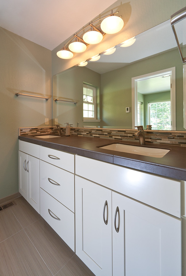 Schuetz Master Bath  New painted maple cabinets by WayPoint are full adult height with oversized tile used for a counter.  Sinks are undermount.  Check out the stone & glass backsplash!   Note:  beveled mirror is custom sized to sit tight to the backsplash.