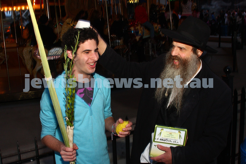 Chabad Youth. Sukkot at Luna Park 2009. Daniel Goodman benching the Lulav.photo: peter haskin