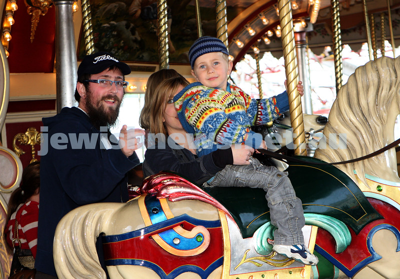 Chabad Youth. Sukkot at Luna Park 2009. Yaakov Belfer with his son Zaki. photo: peter haskin