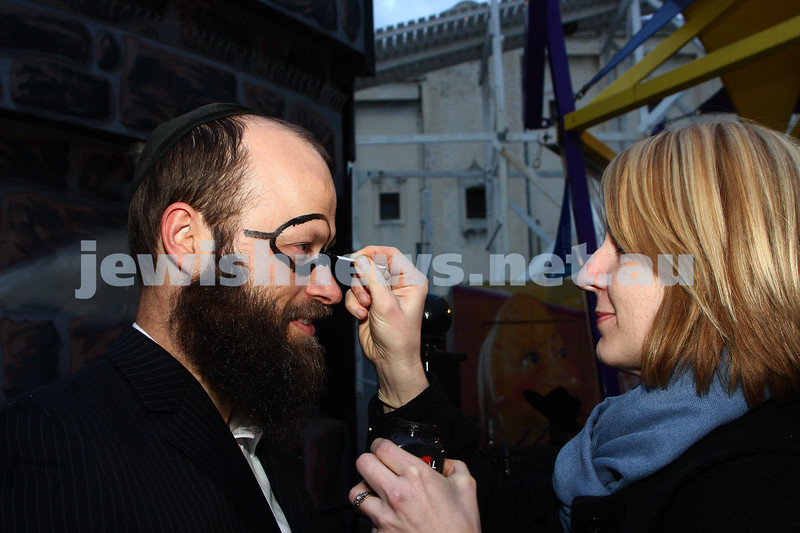Chabad Youth. Sukkot at Luna Park 2009. Menachen Vorcheimer gettiing the Harry Potter treatmnt at the face painting stand.  photo: peter haskin
