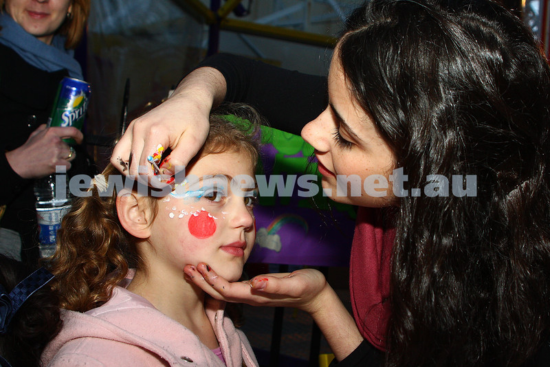 Chabad Youth. Sukkot at Luna Park 2009. Chani Kazatsky having her face painted. photo: peter haskin