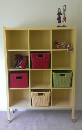 Painted cubby case with basket storage