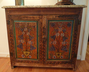 Russian folk painted cabinet with modern Santa Clara granite top w/beveled edge.