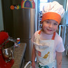 Eve baking in her new chef outfit