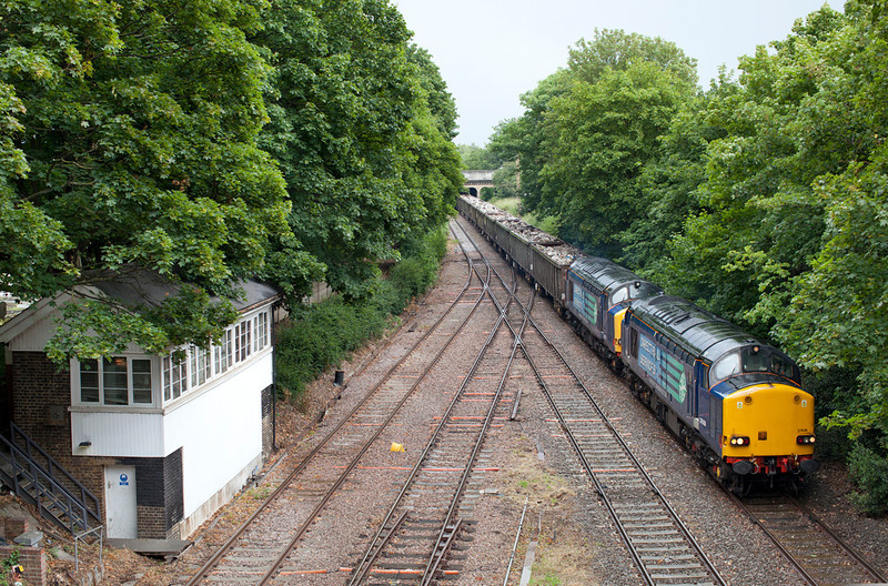 In pouring rain 37608 & 37602 pass Kew East Junction with the 6Z50 09.35 Stockton-Sheerness Scrap Metal train. 18.6.11