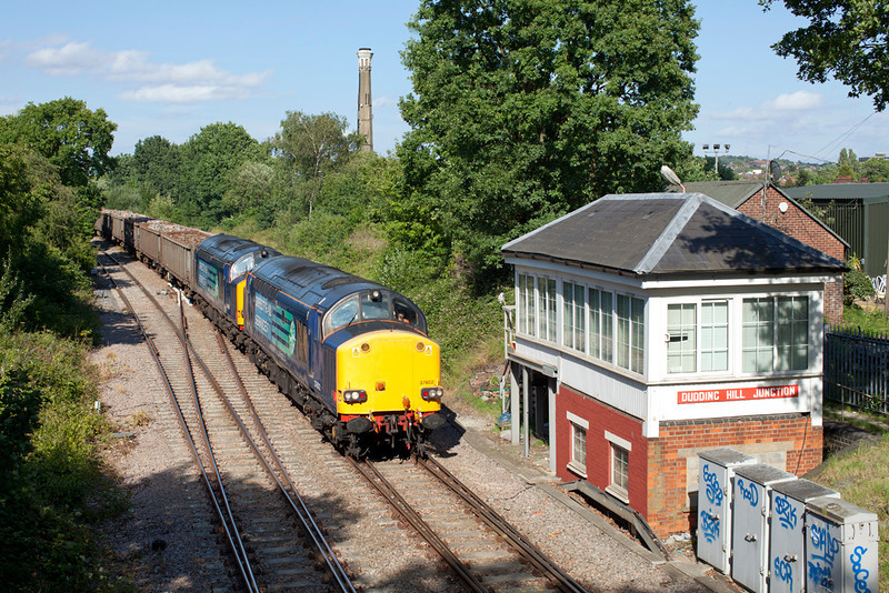 37602 & 37608 pass Dudding Hill Junction with the 6Z50 09.35 Stockton-Sheerness loaded scrap metal train.25.6.11