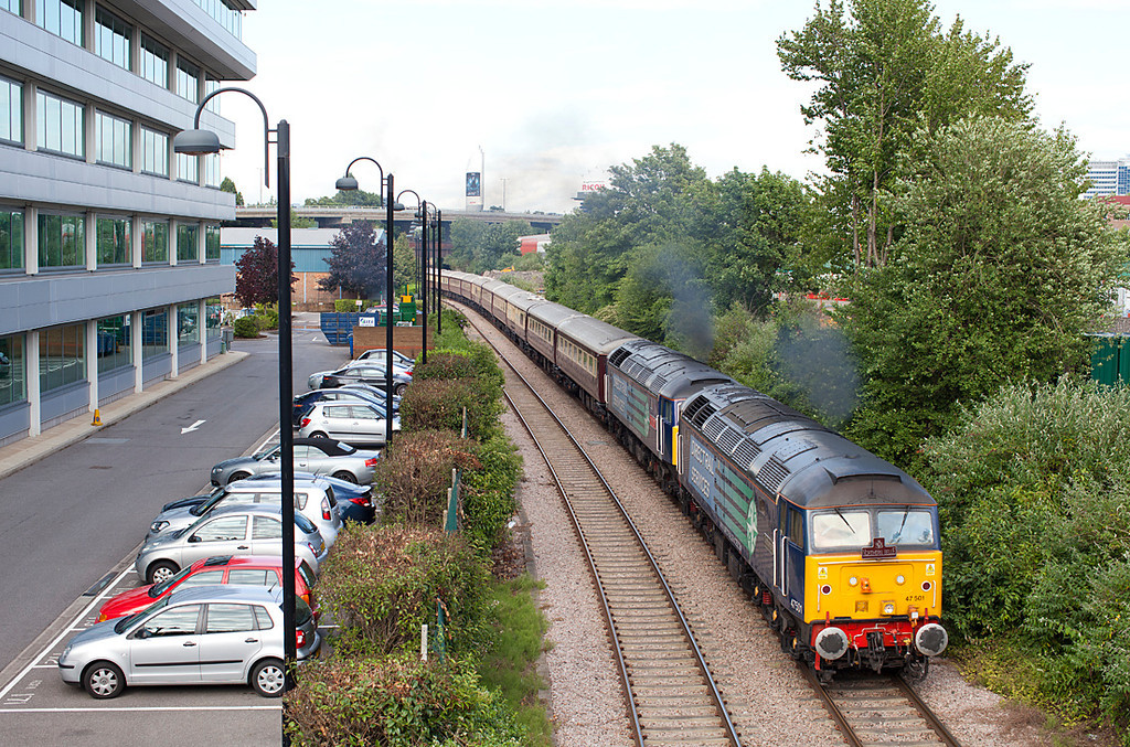 With the M4 in the background 47501 & 47810 approach Old Kew Junction on Acsot Ladies Day with the Wembley-Ascot Northern Belle ECS. 16.6.11