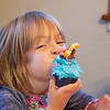 Eve devouring her cupcake