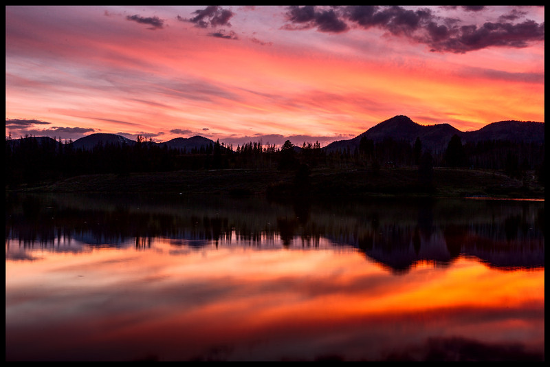 I get to work in Steamboat Springs, CO sometimes.  When I do, I always bring my camera in hopes to capture scenes like this.  This is a sunset image of Steamboat Lake.