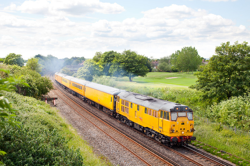 Making a pleasant change from the 73107/73138/73201 combination. 31285 leaves Shepperton with the 1Q28 09.15 Hither Green-Hither Green Network Rail measurement train via Kingston and Shepperton. 31233 is the rear loco.13.6.12