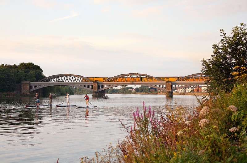 73138 heads over Barnes Bridge on a rare, warm summers evening with the 'Serco' returning to Derby from Hither Green.