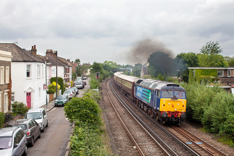 In pouring rain, 47805 opens up through the streets of Mortlake with the 5Z55 Ascot-Stewards Lane Northern Belle 'Ladies Day' ECS.