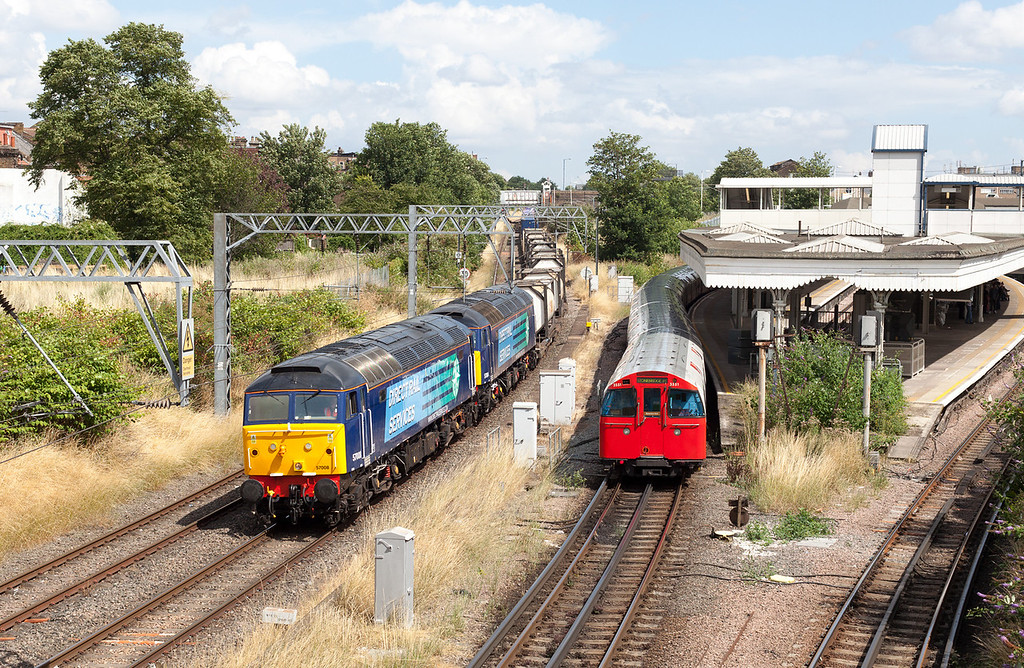 An immaculate 57008 leads 57004 past Willesden Low-Level with the late running 4M71 11.29 Purfleet-Daventry DRS Malcolm Intermodal. 29.7.13