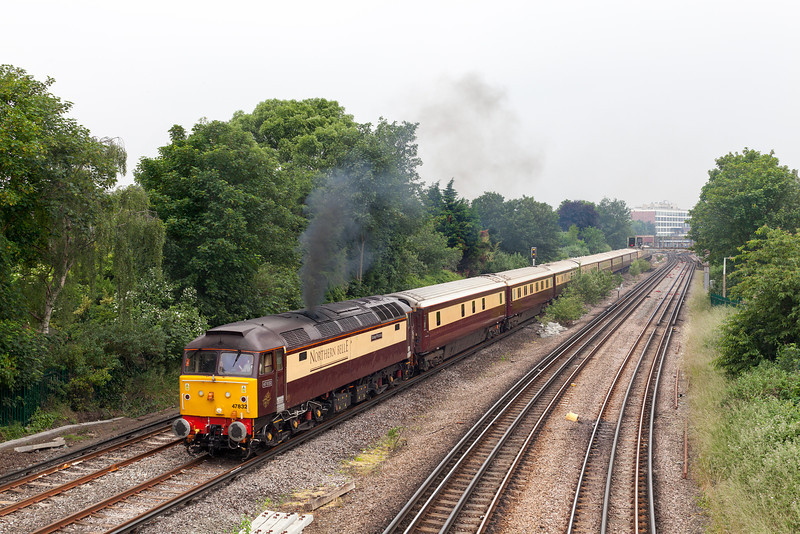 Dull, dull and more dull, in predictable summer weather 47832 opens up through Richmond with the 12.32 Ascot to Stewarts Lane T&RSMD 'Ladies day' special ECS. The train had earlier originated in Manchester.20.6.13