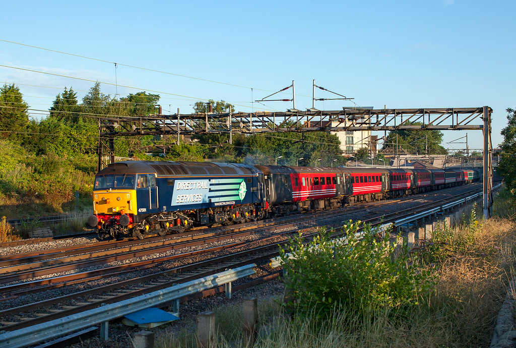 """Return of the football special? 47501 flies through Kenton taking hundreds of 'jocks' to Wembley with the 1Z82 23.48 Edinburgh-London Euston . 1/640s F5.6 250ASA<br /> This location (Sainsburys car park) was once a very popular location for southbound trains between Watford Junction and Euston, but sadly in recent years the embankment has become very overgrown. Compare this photo with one taken in 2009 <a href=""""http://smrail.smugmug.com/Other/Railways-in-England-during/i-XCr5p7Z/A"""">http://smrail.smugmug.com/Other/Railways-in-England-during/i-XCr5p7Z/A</a>"""