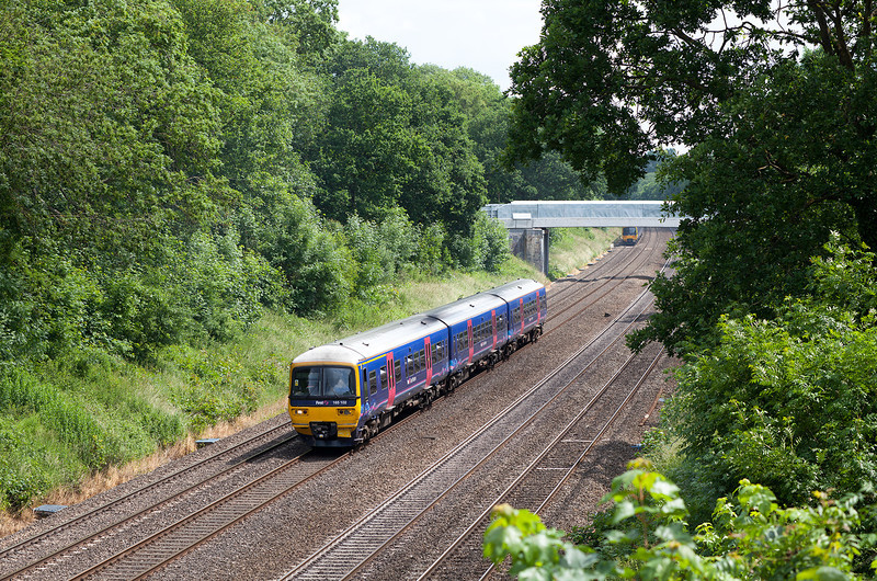 Taken from Butts hill road and looking towards Duffield road, Sonning cutting, 165102 heads towards Reading with a lunchtime service from Paddington.25.6.13