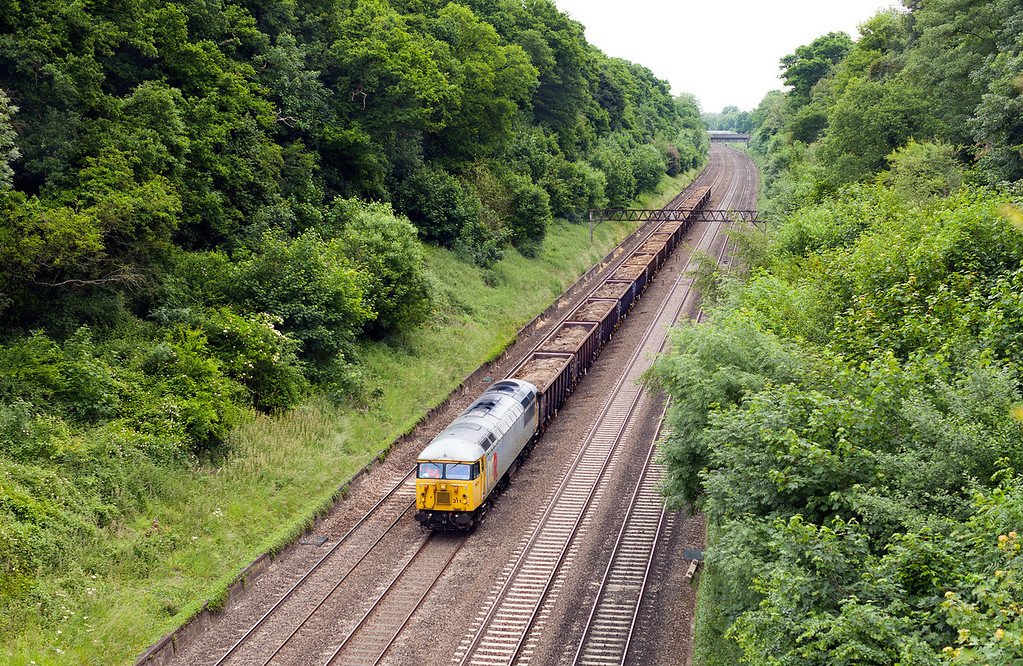 Complete this well known phrase or saying, it was sunny until.... In very hot, humid weather, 56311 rumbles through Sonning Cutting with the 6Z48 13.15 Willesden Euroterminal-Calvert loaded spoil train.19.6.13