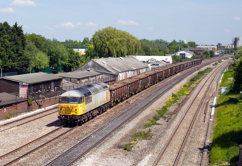After running around in Hanwell loop, 56311 thunders through West Drayton with the 6Z48 MW0 13.15 Thorney Mill-Calvert loaded spoil train. 5.6.13