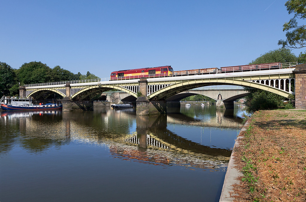 On a stunning summer Sunday morning, 60065 crosses Richmond Bridge with the 6N13 05.26 Eastleigh East Yard to Addlestone engineering train.7.7.13