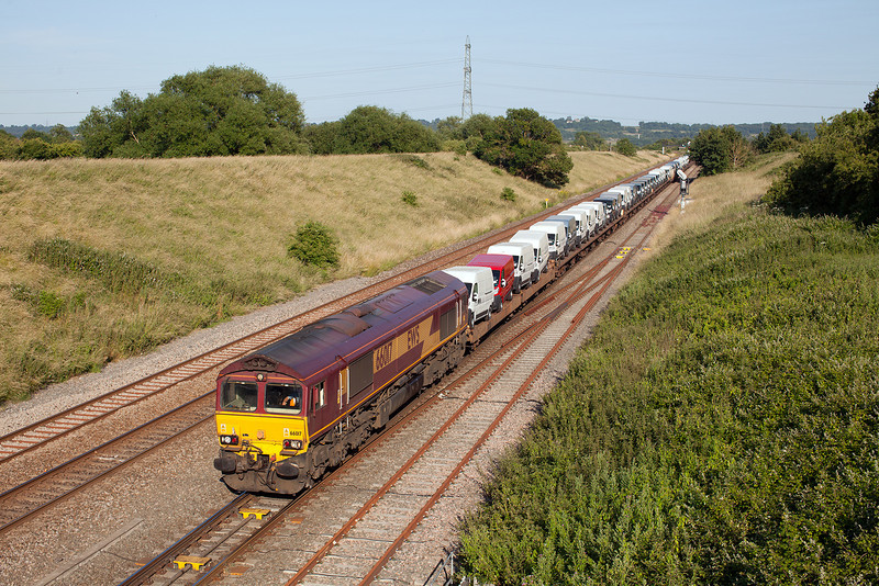 66017 drifts slowly past Pilning loop with the 17.33 Portbury Automotive terminal-Mosssend loaded imported van train.11.7.13