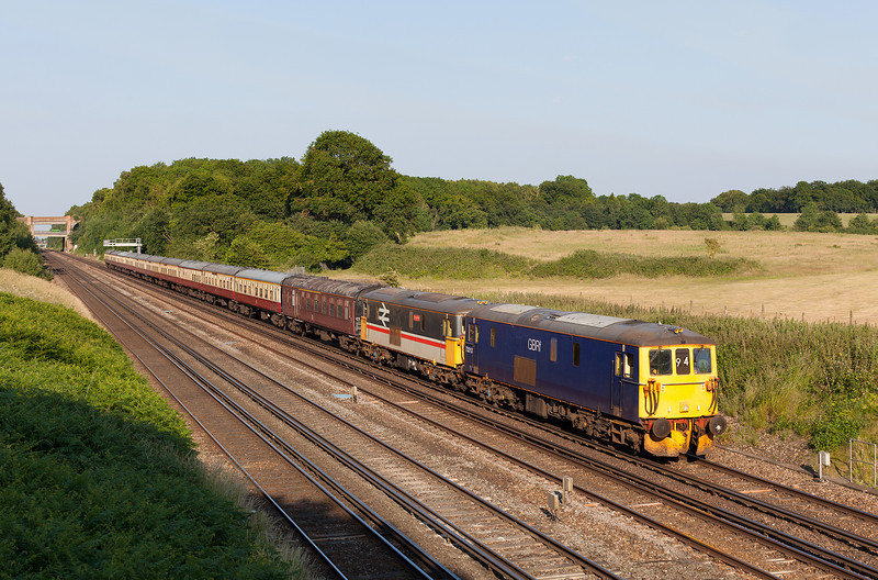 73213&73205 speed past the gallery at Totters Lane, Winchfield with the 5Z94 13.21 Doncaster Royal Mail terminal-Eastleigh return GBRF ECS. 7.7.13