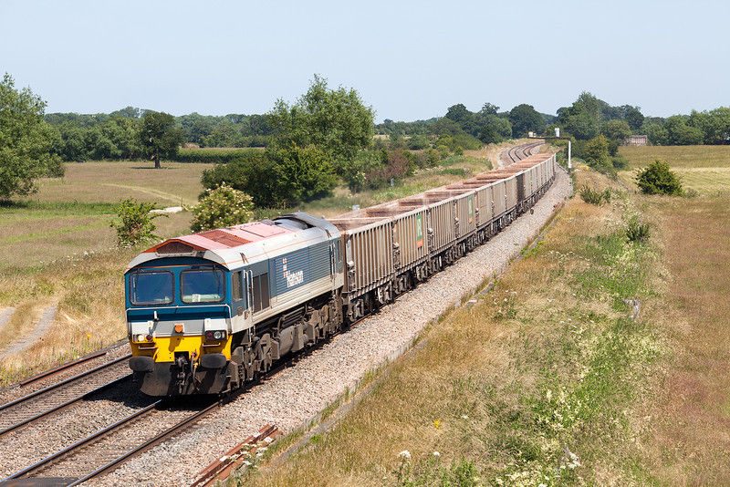 With temperatures in the high 20's, 59102 rumbles through the high speed curves on the Great Western Mail at Ashbury Crossing, Shrivenham with the Banbury Road-Westbury empty stone train.11.7.13