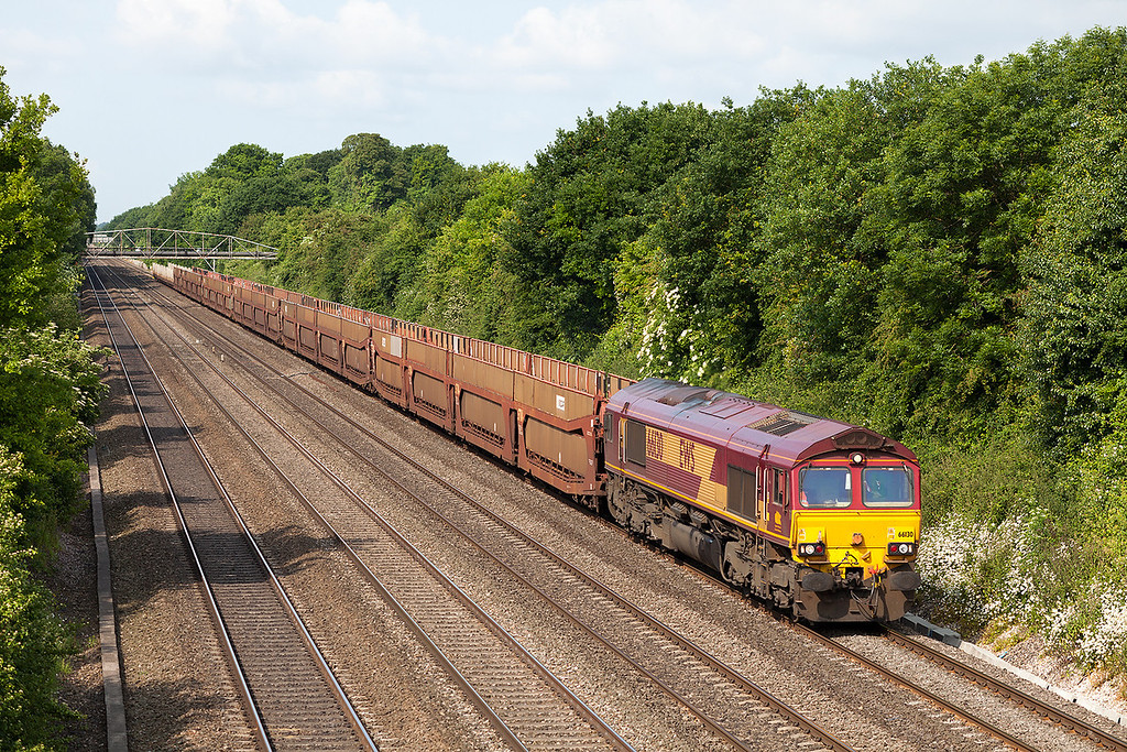 How this scene will change when the wires go up! 66130 heads towards Maidenhead at Shottesbrook farm road bridge with 08.08 Didcot TC-Dagenham Dock empty car carriers.25.6.13