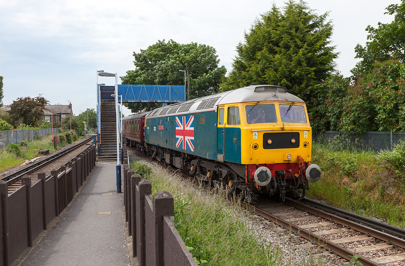 In hazy summer sunshine, 47580 'County of Essex' opens up through the suburban tranquility of North Sheen with the 5Z83 10.35 Bristol Kingsland Road-Southall ECS.17.6.13