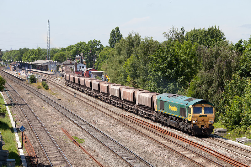 With the increasing signs of electrification prevalent, 66607 leaves West Drayton with the Thorney Mill-Bardon empty stone train.5.6.13