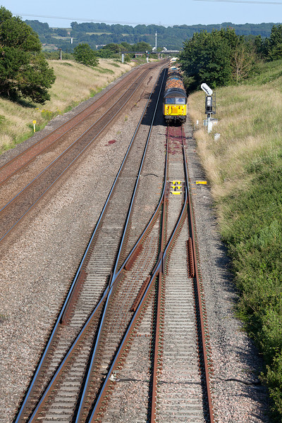 Colas Rail's 56302 waits in it's booked path at Pilning on a sweltering 11th July before leaving the loop with the 14.53 6Z53 Teigngrace-Chirk loaded logs train.