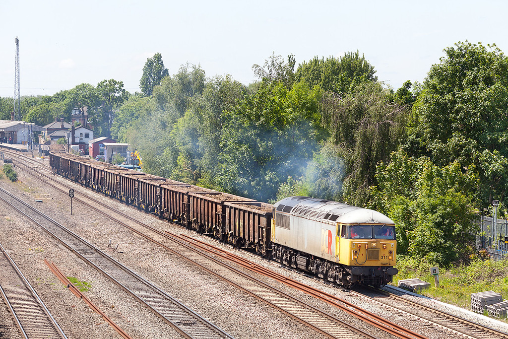 Catch this location before the wires go up! In beautiful summer sunshine a rather grubby 56311 leaves West Drayton with the 6Z48 13.15 MWo Thorney Mill-Calvert loaded spoil train.5.6.13