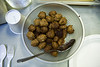 A bowl of really unappetizing and nearly inedible objects disguised as meatballs prepared for dinner by the chefs at a Boy Scout camp.