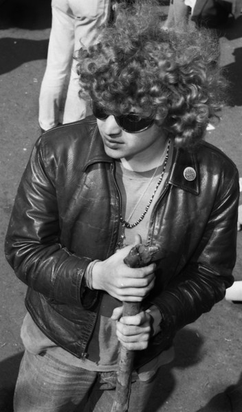 As if posing for Milton Glaser's famous 1967 poster of Bob Dylan, this young man stands out in the crowd as a Hippie of style. The leather, beads, shades and walking staff give him a level of panache. If I were given to radical altering of photographs in Photo Shop, I'd be temped to turn this image into a Glaser poster. One day perhaps I'll make this shot look like Dylan in silhouette with a shock of wavy psychedelic hair.