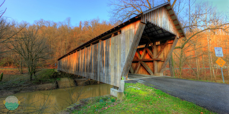 Bennett's Mill<br /> (Mar 1) Covereed bridge that goes over Tygart's Creek.  Built in 1855 and never painted, the wood has aged to be this rustic color.  The only covered bridge of its design left.  Wheeler's design.  The other 6 that were in Ohio have been gone for decades.  This is the hdr version of the previous normal panormaic of the bridge.  3 shot HDR.