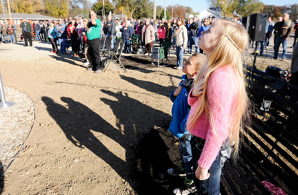 Don Knight | The Herald Bulletin<br /> Over 100 people turned out for the dedication of new monument honoring veterans in Summitville on Saturday. The event was the culmination of 10 years of work to get the monument built.