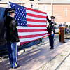 Don Knight | The Herald Bulletin<br /> From left, Army Sergeants Daniel Fitz and Megan Mason unfurl the American flag during the dedication of a new monument honoring veterans in Summitville on Saturday.