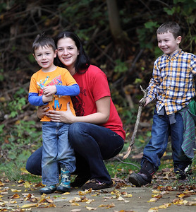 Elyrian's Max Sexton, left, age 3, and Chase Sexton, right, age 6, pose with their aunt Tiffany Sexton during a walk in Cascade park Sunday. photo by Ray Riedel