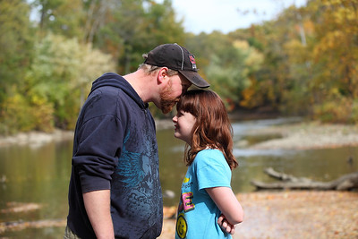 Scott Macdonald and his daughter Katie Macdonald, age 12, of Lorain, share a moment by the river in Cascade park. photo by Ray Riedel