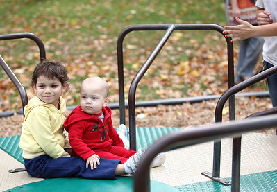Evalesa Serrano, age 4, and her little brother Stephan Serrano, age 11 months, both of Elyria enjoy a spin at Cascade park. photo by Ray Riedel