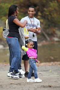 Little Tayannia Carter, throws food to the ducks with her older cousins, Santeja Shannon and Bobby Shannon of Elyria. photo by Ray Riedel
