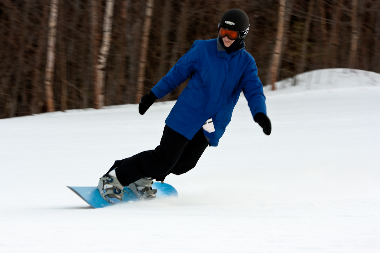 Abby snowboarding on Tempest.