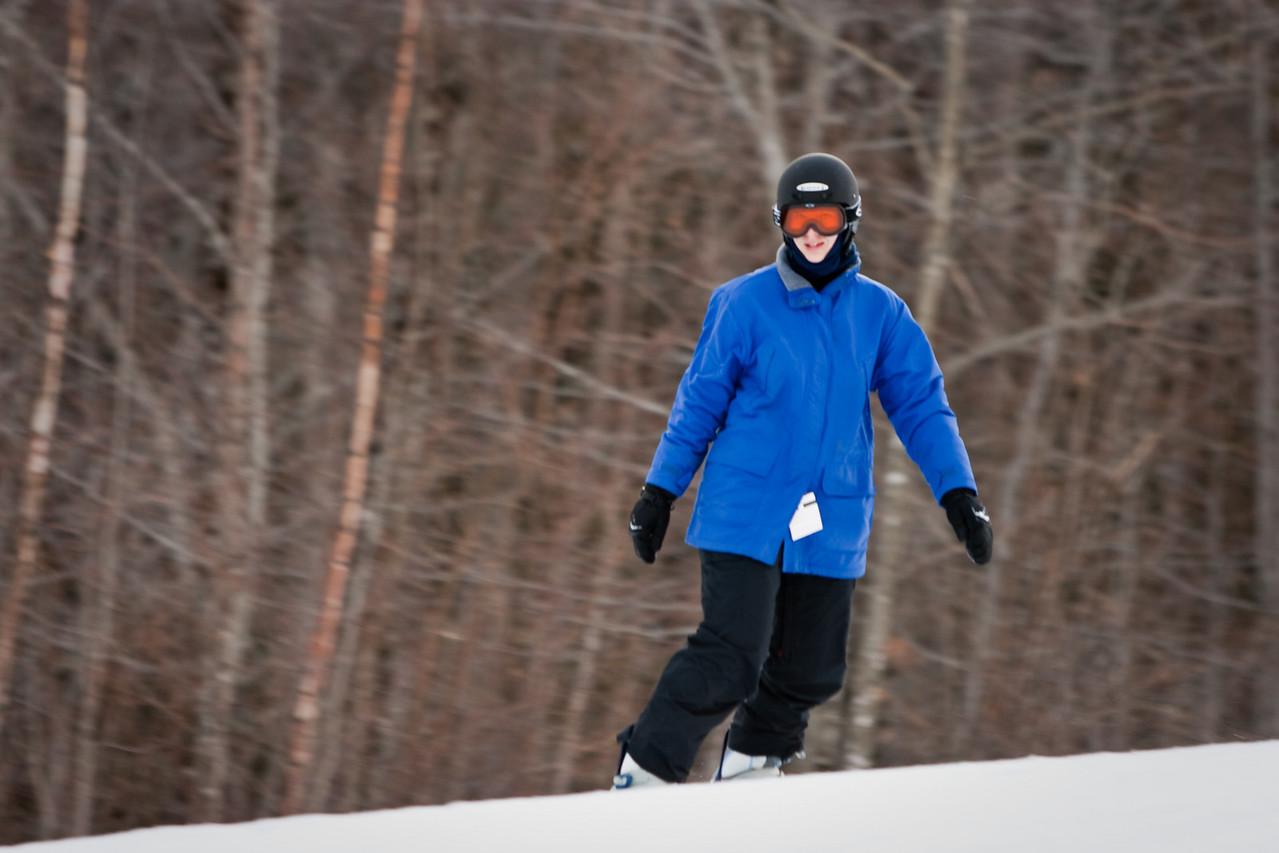 Abby snowboarding on Tempest.