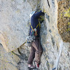 Noal leading the beginning of the third pitch. I belayed high and right of the route but it would have been better to stay in the groove below the slightly overhanging section. This is the crux here, steep rock with good holds into an horizontal chimney, making sideways belly-flopping a likely result. The third pitch ends on the north side of the chimney, where the route joins the East Ridge.