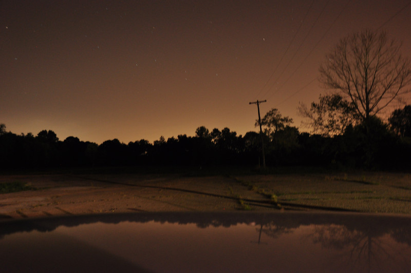 Used the Sepia colored lights from a parking lot at 30 seconds, f 8 for this photo. the lights ehind the trees are distant streetlights.