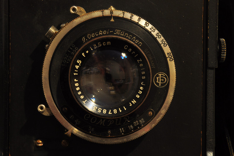 The lens of a Speed Graphic press camera