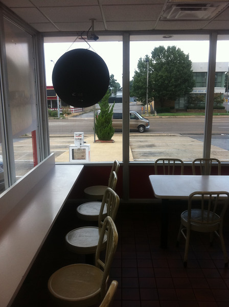 The Krystal on Union Avenue in Memphis has shiny table tops. William Eggleston shot from this same vantage point, though the restaurant has changed over the years