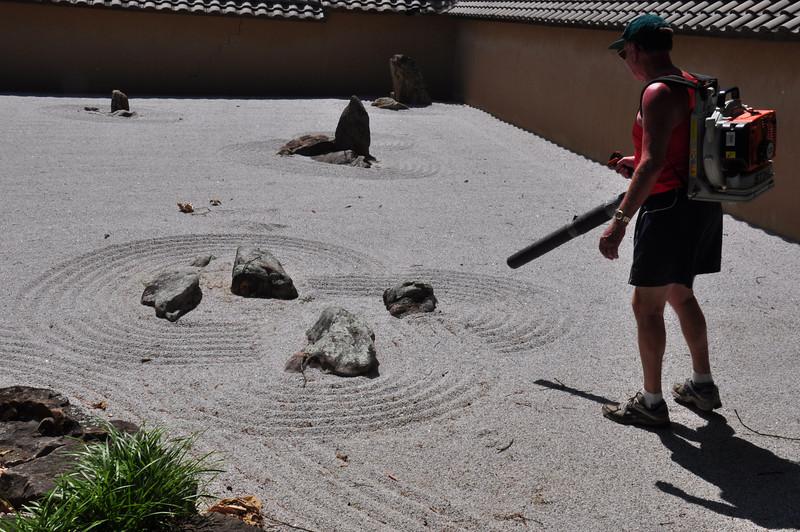A leaf blower in a zen garden