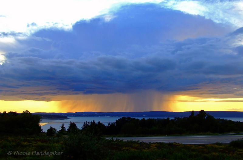 Rain Cloud over Digby taken in August 2008 during Wharf Rat Rally.  This image was used by Canadian Geographic Photography club for advertisement purposes on their website.